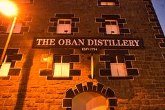 Oban Distillery Scotland. Exterior of still house building .  Oban is themost significant whisky distillery in the Scottish West Coast area. Night shot Stock Photo