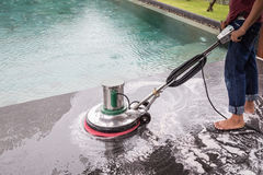 Exterior stone floor cleaning with polishing machine and chemica. Exterior black stone floor cleaning with polishing machine and chemical royalty free stock images