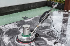 Exterior stone floor cleaning with polishing machine and chemica. Exterior black stone floor cleaning with polishing machine and chemical stock photo