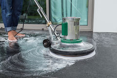 Exterior stone floor cleaning with polishing machine and chemica. Exterior black stone floor cleaning with polishing machine and chemical royalty free stock image