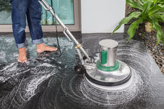 Exterior stone floor cleaning with polishing machine and chemica. Exterior black stone floor cleaning with polishing machine and chemical stock photos