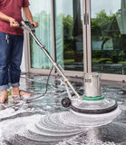 Exterior stone floor cleaning with polishing machine and chemica. Exterior black stone floor cleaning with polishing machine and chemical royalty free stock photo