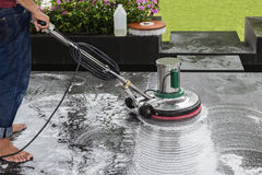Exterior stone floor cleaning with polishing machine and chemica Royalty Free Stock Photos