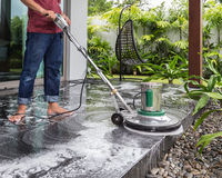 Exterior stone floor cleaning with polishing machine and chemica. Exterior black stone floor cleaning with polishing machine and chemical stock images