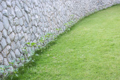 Exterior stone wall decorative in the garden Royalty Free Stock Image