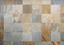 Exterior stone wall made from large travertine tiles of different colors royalty free stock photos