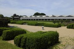 Exterior of the structure covering the remains of Fishbourne Roman Palace, ner Chichester, West Sussex, UK. Panoramic view of the gardens outside the Fishbourne Stock Images