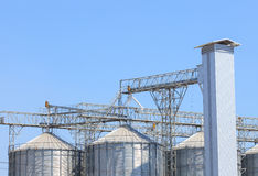 Exterior structure of new agriculture silo building against blue Royalty Free Stock Images