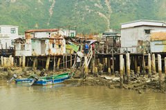 Exterior of the Tai O fishermen village with stilt houses and motorboats in Hong Kong, China. Stock Images