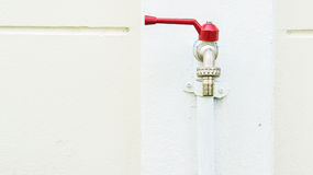 Exterior tap. On white wall background royalty free stock image