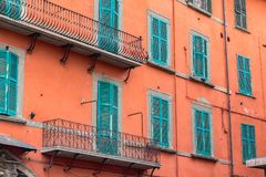 Exterior of traditional Italian buildings with green shutters Royalty Free Stock Photo