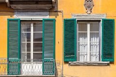 Exterior of traditional Italian buildings with green shutters Stock Image