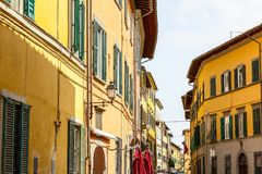 Exterior of traditional Italian buildings with green shutters Royalty Free Stock Photography