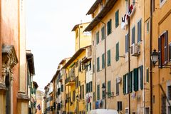 Exterior of traditional Italian buildings with green shutters Stock Photo