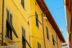 Exterior of traditional Italian buildings with green shutters Stock Photography