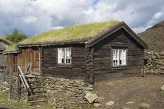 Exterior of the traditional timber house of the copper mines town of Roros, Norway. Grass planted at the roof is a traditional Norwegian way of house Stock Image