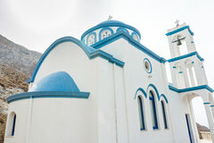 Exterior of traditional white blue Greek Christian. Orthodox church building low angle view Stock Images