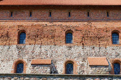 Exterior of the Trakai castle old brick wall with a windows in Trakai, Lithuania. TRAKAI, LITHUANIA - AUGUST 02, 2015: Exterior of the Trakai castle old brick royalty free stock photography