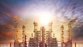 Exterior tube of petrochemical plant and oil refinery for produc. E industrial matterial in heaviy petroleum industry estate against beautiful sun light sky Stock Images