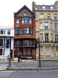 Victorian house, Brighton and Hove, Sussex, England. Exterior of Tudor Victorian style houses on Kings Road, Brighton and Hove, Sussex, England Stock Photos
