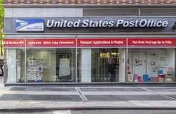 Exterior of USPS office bulding. New York, NY, USA - May 8, 2019: Exterior of USPS office building in NYC. The United States Postal Service is an independent royalty free stock photography