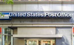 Exterior of USPS office bulding. New York, NY, USA - May 8, 2019: Exterior of USPS office building in NYC. The United States Postal Service is an independent stock image