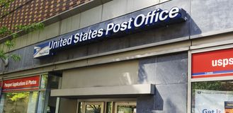 Exterior of USPS office bulding. New York, NY, USA - May 8, 2019: Exterior of USPS office building in NYC. The United States Postal Service is an independent stock photo