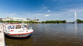 Exterior view of the Alsterarkaden and the lake Kleine Alster in. HAMBURG, GERMANY - JUNE 5, 2016: Exterior view of the Alsterarkaden and the lake Kleine Alster Stock Image