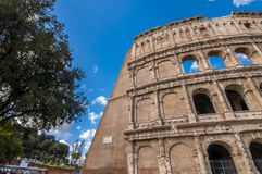 Exterior view of the ancient Roman Colloseum in Rome. Rome, Italy - April 5, 2019: Exterior view of the ancient Roman Colloseum or Flavian Amphitheather in Rome royalty free stock image