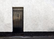 Exterior View of a Beautiful Old English Stone Cottage with door. stock image