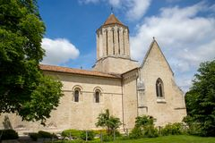 Exterior view of a Catholic Church under bue sky. Exterior view of a Catholic Church with back garden and trees royalty free stock photography