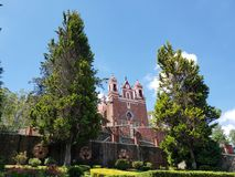 Exterior view of the catholic church the Calvary of the city of Metepec, in Mexico, on a sunny day. Located in the state of Mexico, travel and tourism stock photo