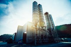 Exterior view of a cement factory. Concrete mixing silo, construction site facilities stock photography