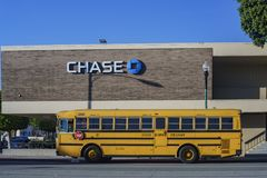 Exterior view of the famous Chase Bank and yellow school bus. Los Angeles, JAN 23: Exterior view of the famous Chase Bank and yellow school bus on JAN 23, 2018 Stock Photos