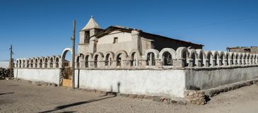 An exterior view of the front of the small church in the village of Tahua, Bolivia Stock Photos
