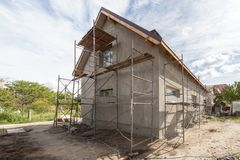 Exterior view of new house under construction and painting Royalty Free Stock Image