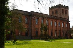 View of St. Andrews Church, Penrith - Landmarks in Penrith, Cumbria. An exterior view of a red sandstone church building with tower in the Cumbrian town of stock photography
