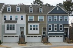 A row of four-story townhouses. stock photos