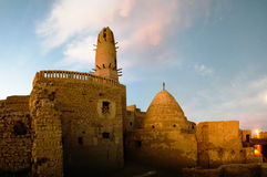 Exterior view to Al-Qasr old town and mosque, Dakhla oasis, Egypt Royalty Free Stock Image