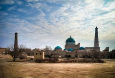 Exterior view to Mausoleum of Pahlavon Mahmoud, Juma mosque and Khoja minor minaret at Itchan Kala, Khiva, Uzbekistan. Exterior view to Mausoleum of Pahlavon stock images