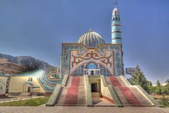 Exterior view to Naryn Central Mosque, Kyrgyzstan. Exterior view to Naryn Central Mosque - 15 september 2016 Naryn Kyrgyzstan royalty free stock photo