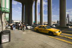 Exterior view of yellow taxi cab in front of the 30th Street Station, a national Register of Historic Places, AMTRAK Train Statio. N in Philadelphia, PA royalty free stock photography