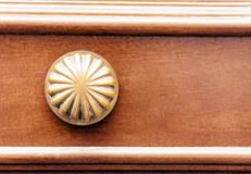 Exterior vintage door handle with a bronze finish on a brown front door in historic building Catania, Sicily, Southern Italy.  stock photography