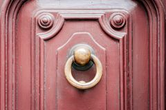 Exterior vintage door knocker metal circle on a door of an ancient building in Catania, Sicily, Italy stock photo