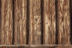 Exterior wall background with board and batten wood, heavily weathered, peeling and cracked paint. Horizontal aspect royalty free stock photography