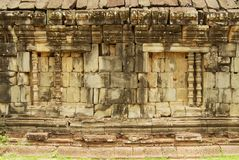 Exterior of the wall of the Bakong temple ruin in Siem Reap, Cambodia. Stock Photos