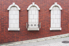 Exterior wall decorative feature. With red brick background Stock Images