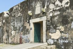 Exterior wall and entrance to the Guia Fortress in Macau, China. Royalty Free Stock Images