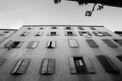 Exterior wall with many windows and shutters, building and archi Stock Images