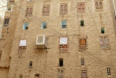 Exterior wall of the mud brick tower house in Shibam, Hadramaut valley, Yemen. Royalty Free Stock Images